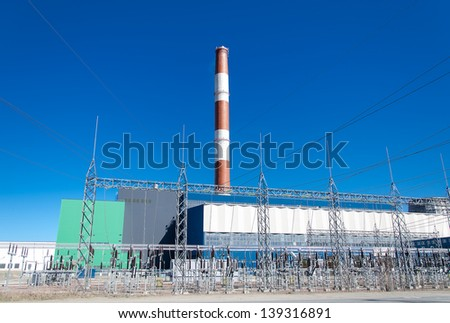 Electric power plant over blue sky. - stock photo
