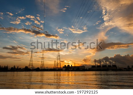 Electric power station at sunrise - stock photo