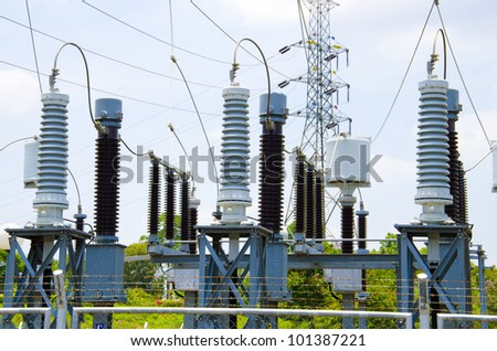Electric power station in blue cloudy sky - stock photo