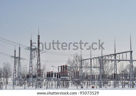 Electric power station with high voltage generators and pylons - stock photo