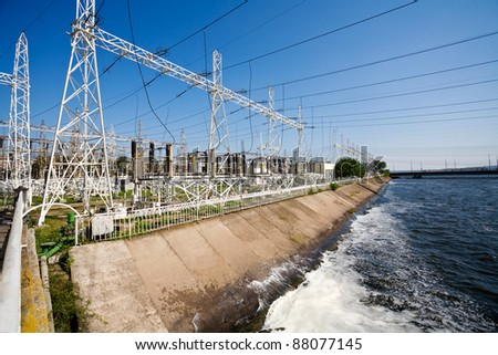 Electric power station with poles cables and powerful transformers - stock photo