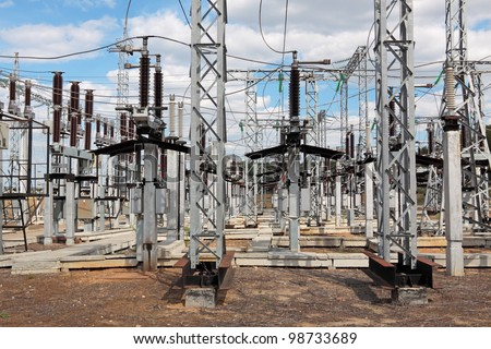 Electric power substation, high-voltage support, conductors and insulators - stock photo