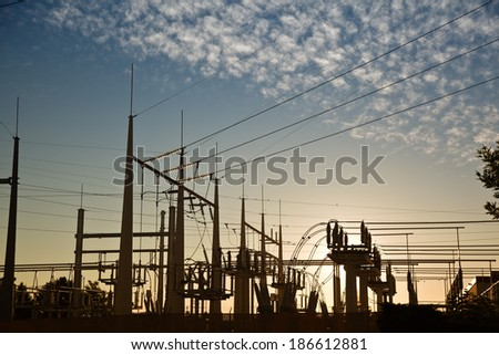 electric power transformation substation in sunrise - stock photo