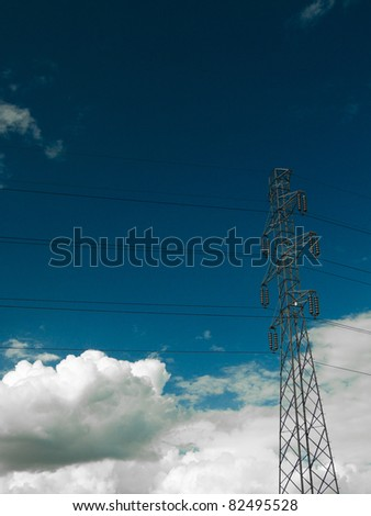 Electric power transmission lines at blue sky