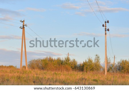 Electric power transmission lines at evening, Russia.