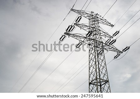 Electric power transmission or power grid pylon wires, transmission tower in Poland, horizontal orientation, nobody. - stock photo