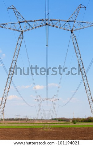 Electric powerlines across a beautiful fields