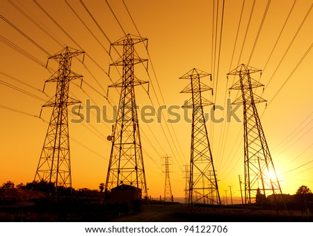 Electric Powerlines at Sunset - stock photo