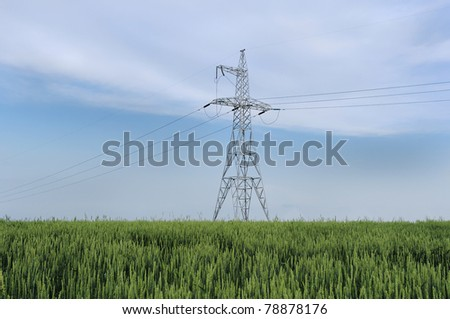 Electric powerlines on blue sky background - stock photo