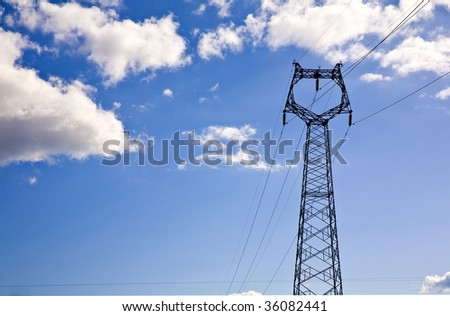 electric pylon against  the sky - stock photo