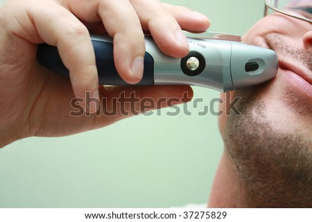 Electric razor man shaving