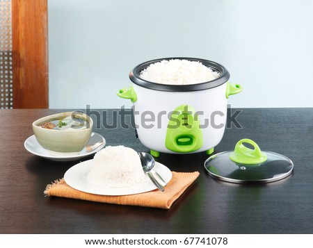 Electric rice steaming pot a nice kitchenware - stock photo