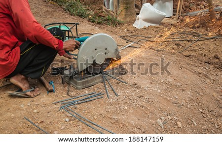 electric saws with hand grinder. Sparks while grinding iron. - stock photo