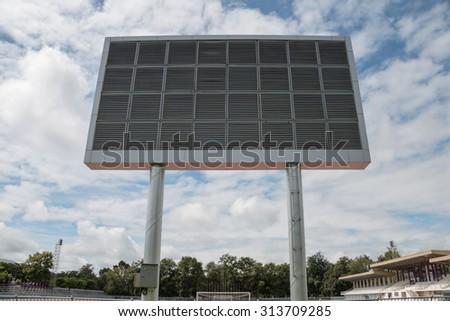 Electric scoreboard in university stadium  - stock photo