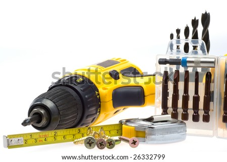 Electric screwdriver and accompanying equipment on a white background - stock photo