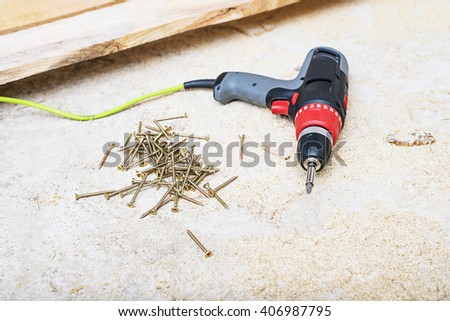 electric screwdriver on wooden background, Cordless drilling screwdriver machine  - stock photo