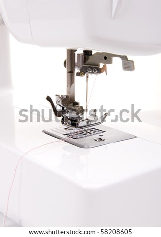 Electric sewing machine on a white background