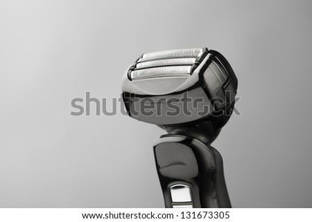 electric shaver on grey background