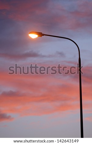 Electric Street lamp at dawn - stock photo