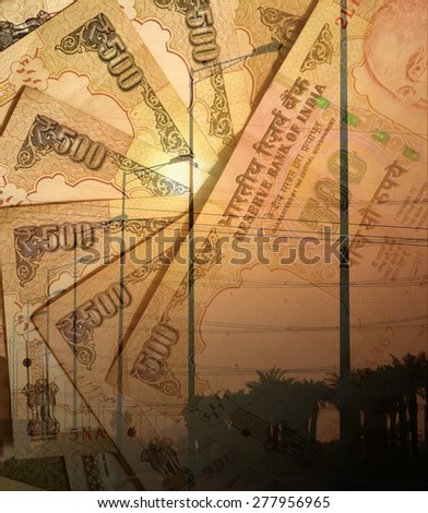 Electric street lamps and Indian 500 Rupee notes, a double exposure shot for demonstrating spend on electricity  - stock photo