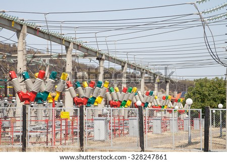 Electric substation against the blue sky. High voltage - stock photo