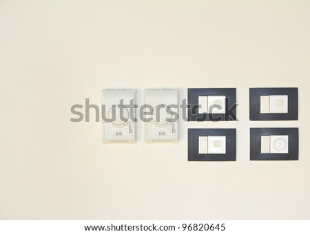Electric switch on wall background - stock photo