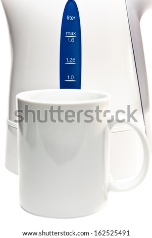 electric tea kettle on a white background and a mug - stock photo