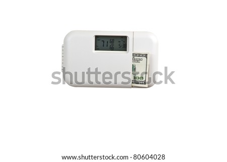 Electric thermostat with currency on white background - stock photo