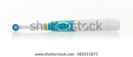Electric toothbrush isolated on a white background - stock photo