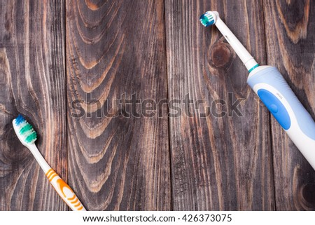 Electric Toothbrush on a black wooden background - stock photo