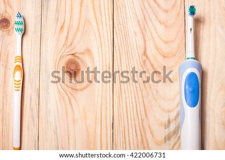 Electric Toothbrush on a light wooden background - stock photo