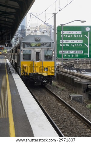 Electric train in Sydney, Australia arriving at train station - stock photo