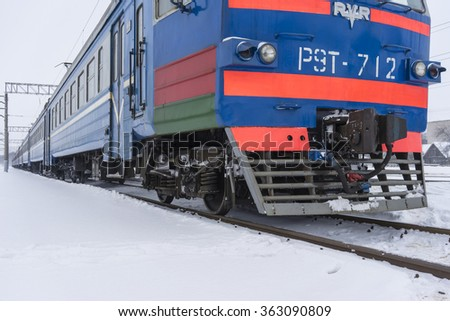 electric train in winter - stock photo