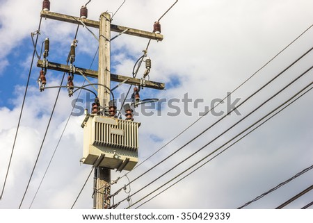 electric transformer on pole - stock photo