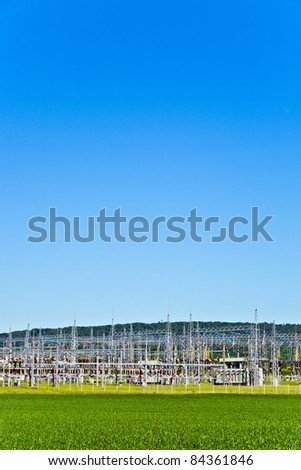 electric transformer station in beautiful landscape - stock photo