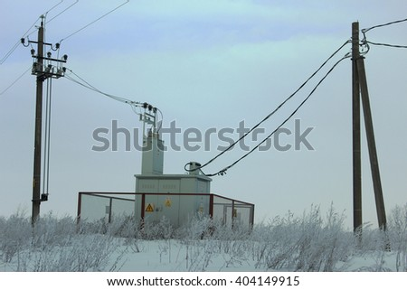 Electric transformer substation high, low voltage. snow - stock photo