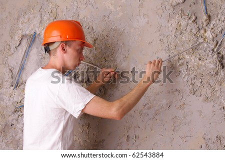 electric trying to fix the broken wires - stock photo