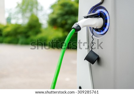 Electric vehicle charging station - stock photo