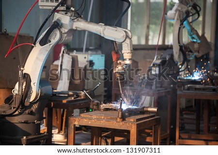 electric welding in a car spare workshop - stock photo