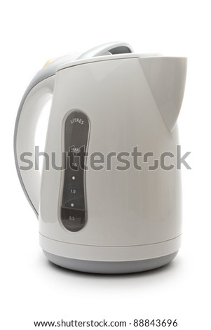 Electric white kettle on the white background - stock photo