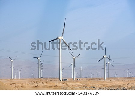 Electric wind turbine generators in the desert in Egypt - stock photo