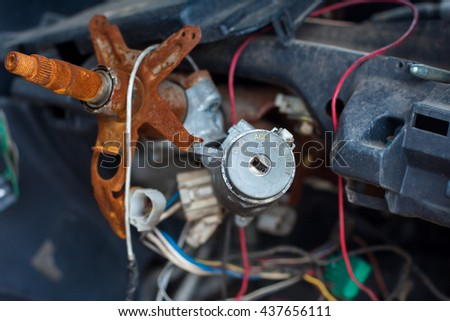 electric wire and key in the Car Wreck