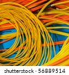Electric wires of red and yellow - stock photo
