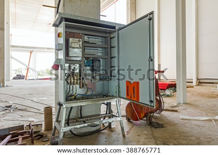 Electrical cabinet with connectors is providing electrical energy to construction site. - stock photo