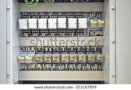 Electrical control panel with relays and wires closeup