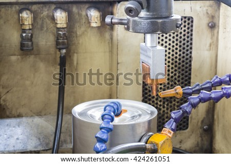 Electrical discharge machine spark eroding with water - stock photo