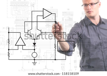electrical engineer drawing circuit diagram on the whiteboard - stock photo