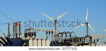 electrical equipment and 2 wind turbines - stock photo