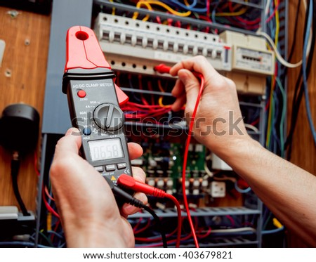 Electrical Equipment Tester In The Hands Background And Texture