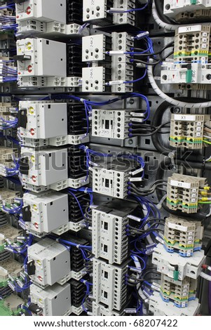 Electrical equipment with miniature circuit breakers, terminals and relays. - stock photo